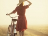 Woman in hat with a bike