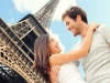 Couple embracing in front of Eiffel Tower