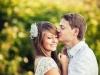 Man tenderly kissing fiancé