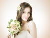 Young beautiful bride with a wedding bouquet